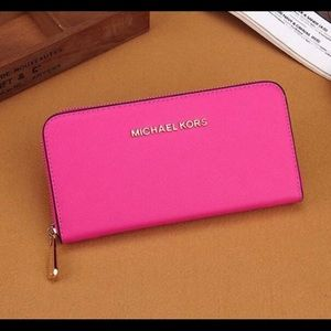 MK hot pink wallet